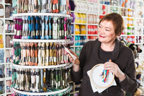 Client is buying colorful mouline threads Poster