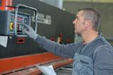 operating a machine - 175875976