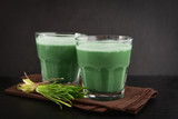 Two green barley grass shots - 175880593