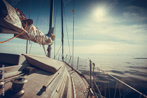 Plexiglas Zeilen Yachting on sail boat during sunny weather
