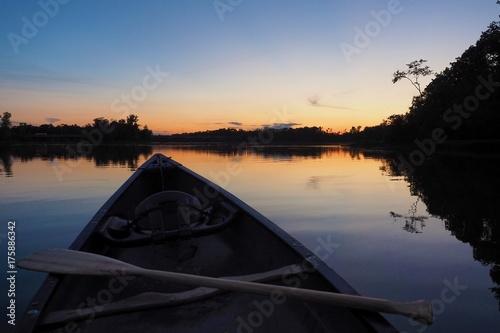 Vászonkép sunset canoe