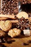 Aroma coffee chocolate cookies and spices on the wooden table. Dark wooden background. Top view. Close. Closeup. - 175888527