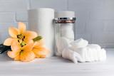 Paper towel, cotton pads and cotton wool - hygienic disposable products - concept of body care and cosmetic products.