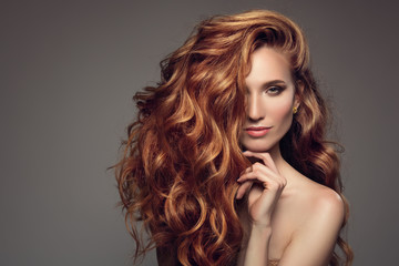 Portrait of woman with long curly beautiful ginger hair. © yuriyzhuravov