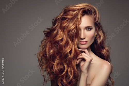 Portrait of woman with long curly beautiful ginger hair. - 175894981