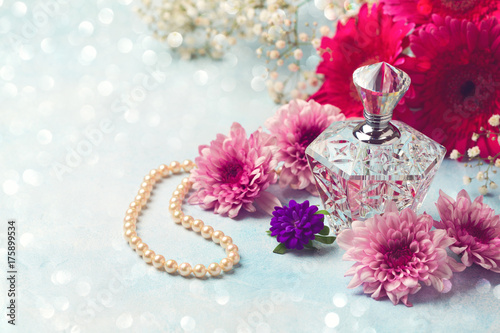 Women perfume bottle and pearl necklace