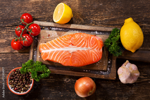 Poster Steakhouse fresh salmon fillet with ingredients for cooking