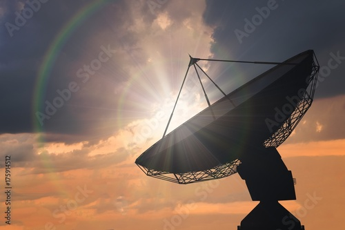Aluminium Heelal Silhouette of satellite dish or radio antenna at sunset.