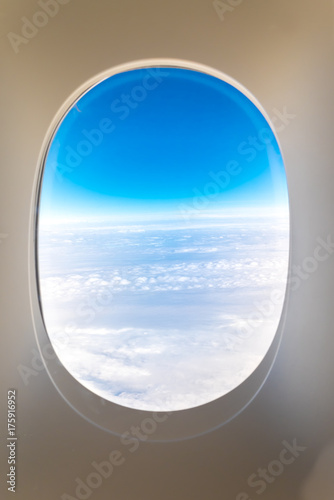 airplane window when flying see through at cloud and blue sky,Transportation,Travel concept