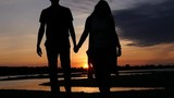 Couple in love walking, holding hands at sunset by the river. HD, 1920x1080. slow motion. - 175917769