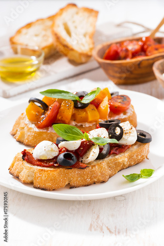 bruschettas with tomatoes and mozzarella, vertical
