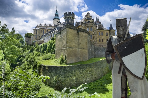 Medieval knight in front of Gothic and Renaissance style castle in Frydlant, Cze Poster