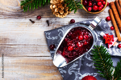 Poster Cranberry sauce in a stainless steel sauce pan on festive christmas background