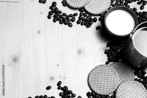 Fotobehang Koffiebonen Coffee beans and milk and cookies