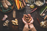 Female woman hands holding jerusalem artichokes or earth pear vegetables on rustic kitchen table with vegetarian cooking ingredients and tools. Healthy and clean food  cooking and eating  concept. - 175944192
