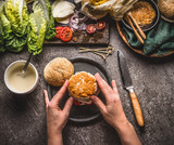 Female women hands making homemade tasty burger with chicken on rustic kitchen table background with ingredients, top view - 175944943
