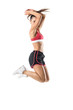 Side view of excited active sporty fit woman jumping in mid air looking down. Full body length portrait isolated on white background.