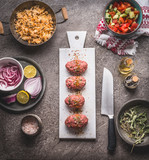 Raw Meat balls on white cutting board on kitchen table background with knife , rice pot and salad dish , cooking preparation , top view. Healthy and clean food and eating  concept. - 175945534