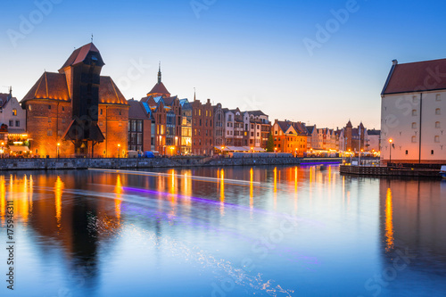 Staande foto Scandinavië Gdansk at night with historic port crane reflected in Motlawa river, Poland