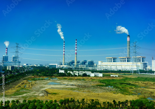 Smoking smokestack of chemical plant with blue sky Poster