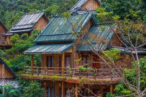 Fotobehang Bamboe Wooden bamboo houses in the jungle. Sanya Li and Miao Village. Hainan, China.