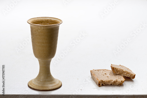 Chalice Of Wine With Bread On The Table