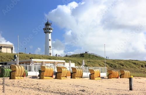 Fotobehang Vuurtoren Lighthouse and beach in Egmond aan Zee. North Sea, the Netherlands.