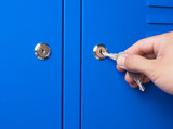 Close up hand opening the metal Locker cabinet - 175973315