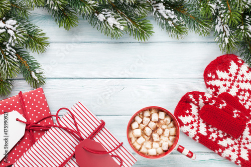 Fotobehang Chocolade Christmas fir tree, gift boxes, hot chocolate