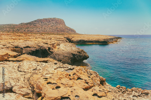 Poster Cyprus View of the open sea. Rocky seashore with blue sky. Beautiful wilderness Cyprus. Limassol