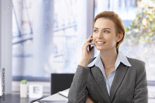 Attractive female talking on mobile - 175994738