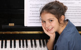 Young girl and piano - 175995777