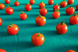 Red tomatoes cherry, scattered in a chaotic manner on a blue background. Food background.