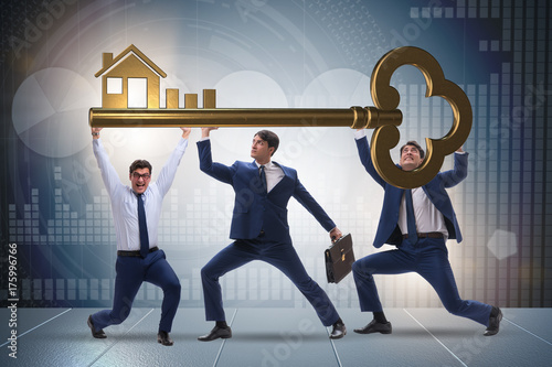 Deurstickers Wanddecoratie met eigen foto Businessmen holding giant key in real estate concept