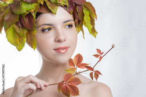 Young woman in autumn wreath
