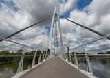 Pedestrian bridge over the Arkansas River by The Keeper of the Plains steel sculpture in Wichita, Kansas - 176001747
