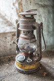 Picture of old old lamp in the abandoned place at the wooden table - 176008385