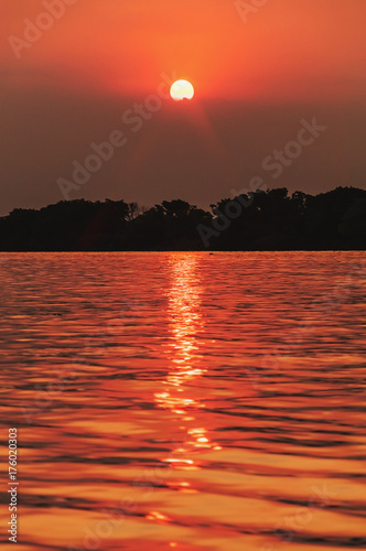 Papiers peints Orange eclat Amazing sunset at Paraguai river in Pantanal, Brazil