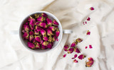 Small rose tea flowers in a cup
