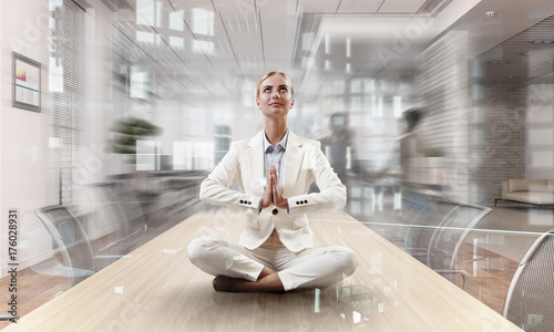 Deurstickers Wanddecoratie met eigen foto Business lady meditating at work. Mixed media