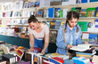 Female teenager is flipping books