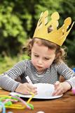 Young kid enjoying painting