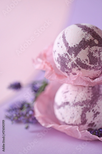 Lavender bath bombs. bomb for a bath with lavender extract on a gentle lilac background and lavender flowers. natural cosmetics concept
