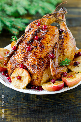 Christmas chicken, turkey baked with cranberries and apples