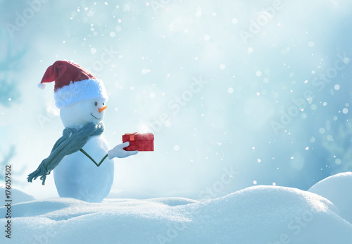 Leinwanddruck Bild Merry christmas and happy new year greeting card . Happy snowman  standing in winter christmas landscape.
