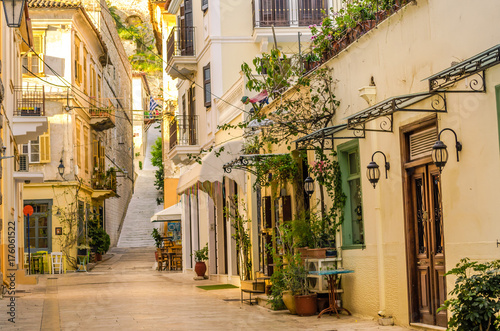 Nafplio-one of the narrow cobblestone alleys with the neoclassical well preserved buildings of the old town. © GIORGOS
