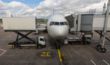 Commercial Jet aircraft docked and being replenished at airport