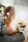 Hairstyle with fresh flowers. rear view close-up. Rustic style - 176074132