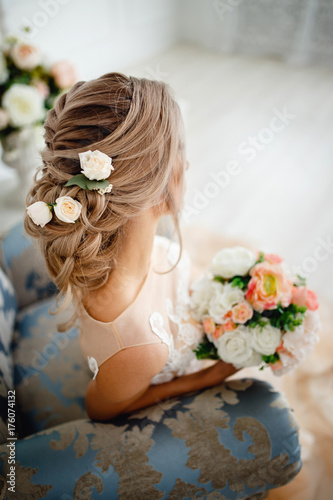 Fotobehang Kapsalon Hairstyle with fresh flowers. rear view close-up. Rustic style