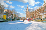 Amsterdam in winter with the Westerkerk in the Netherlands - 176078562